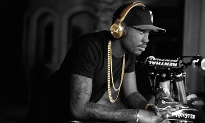 Meek Mill wearing Monster 24K Gold Headphones