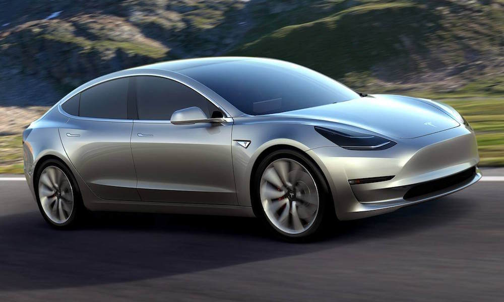 Tesla Model 3 Silver - Front View Driving on Road