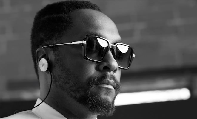 will.i.am wearing i.am+ EPs gold earphones