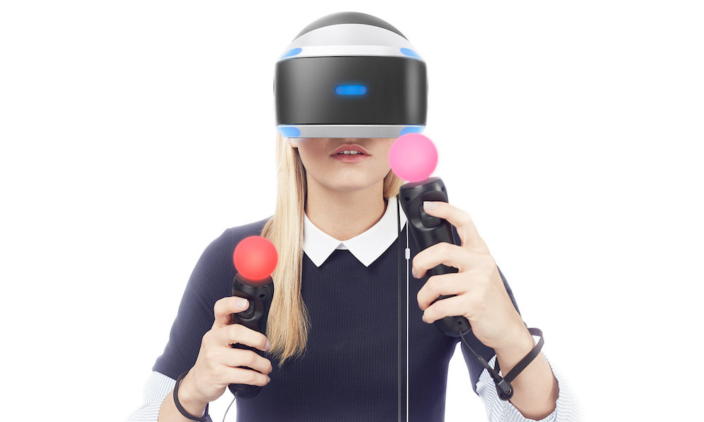 Woman wearing Sony PlayStation VR Headset with Move Controllers