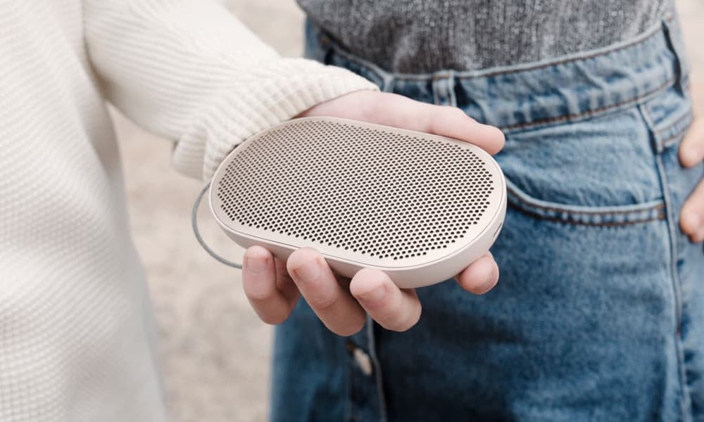 Beoplay P2 Bluetooth Speaker in hand (sandstone color)