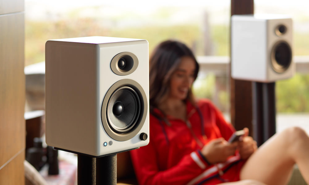 Audioengine A5+ Wireless Speakers in white lifestyle photo