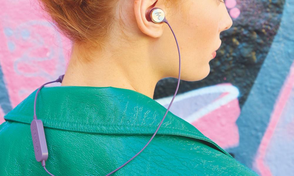 Focal Sphear Wireless In-Ear Headphones in purple on woman