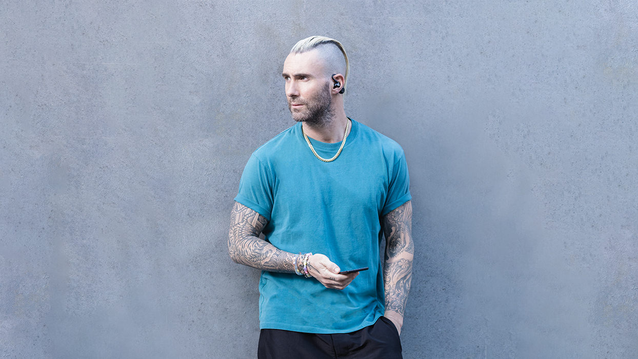 Adam Levine wearing Shure AONIC 215 True Wireless Sound Isolating Earphones