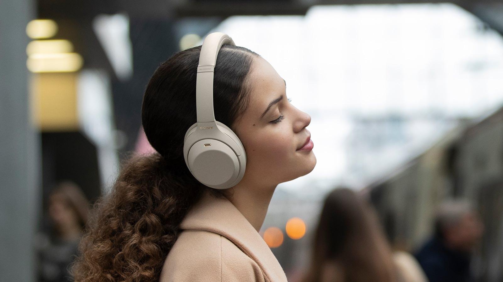 Sony WH-1000XM4 Wireless Noise Canceling Headphones on woman