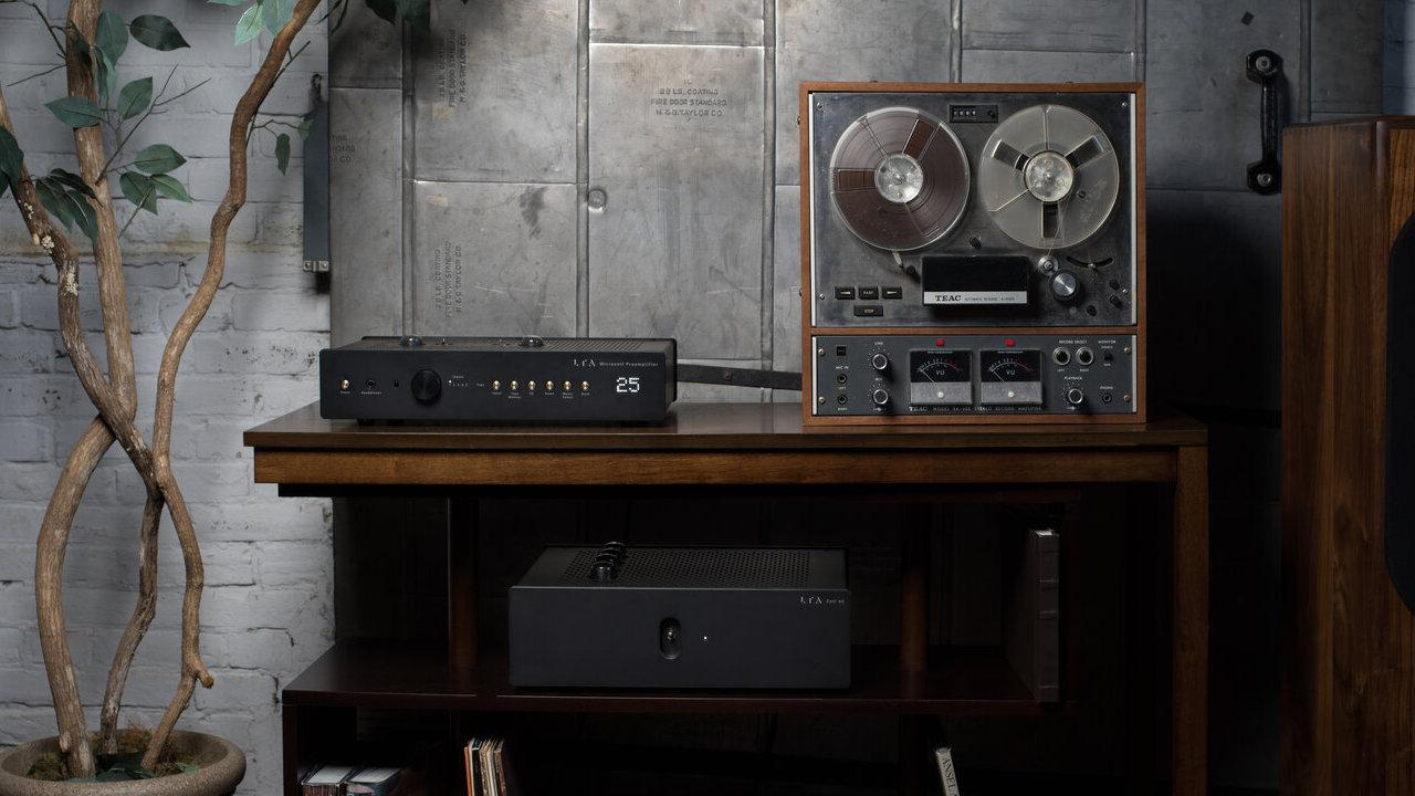 Linear Tube Audio MicroZOTL Preamplifier front view next to reel-to-reel machine