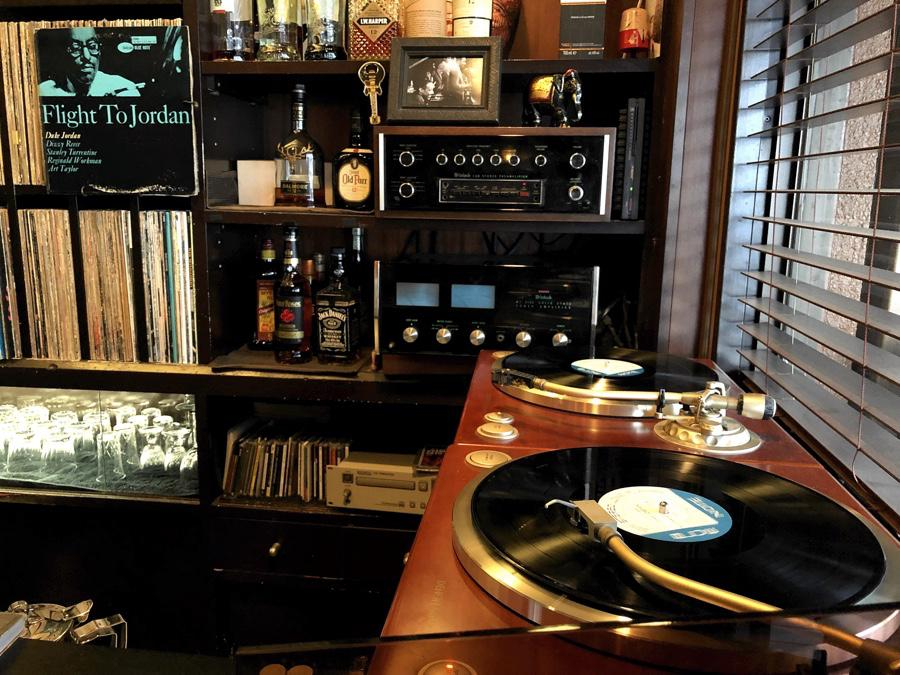Browny's incredible sound system playing Duke Jordan's Flight to Jordan. JBLs at one end (not shown) and at the other, the bar, records, two Denon DP-1300 turntables with Shure V15iii cart's, McIntosh C30 preamp and MC2105 power amp.