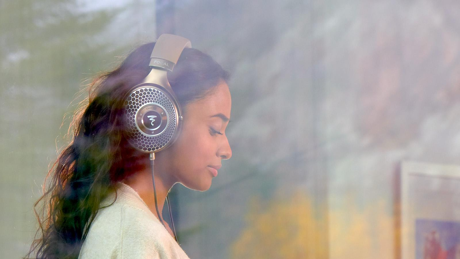 Woman wearing Focal Clear Mg Headphones