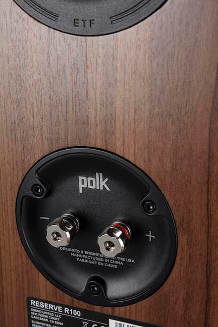 Polk Audio Reserve Series R100 Bookshelf Speaker rear in walnut woodgrain