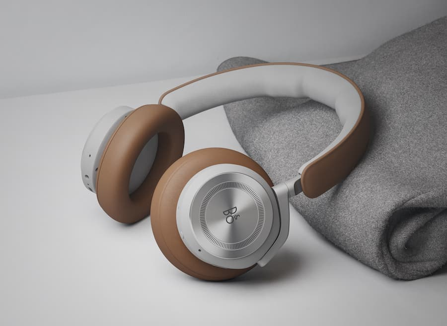 Bang & Olufsen Beoplay HX Wireless Headphones in Timber beside gray blanket