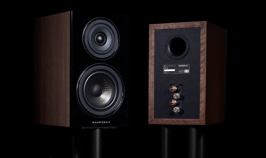 Wharfedale Diamond 12.1 Bookshelf Loudspeakers in walnut on stands facing front and back