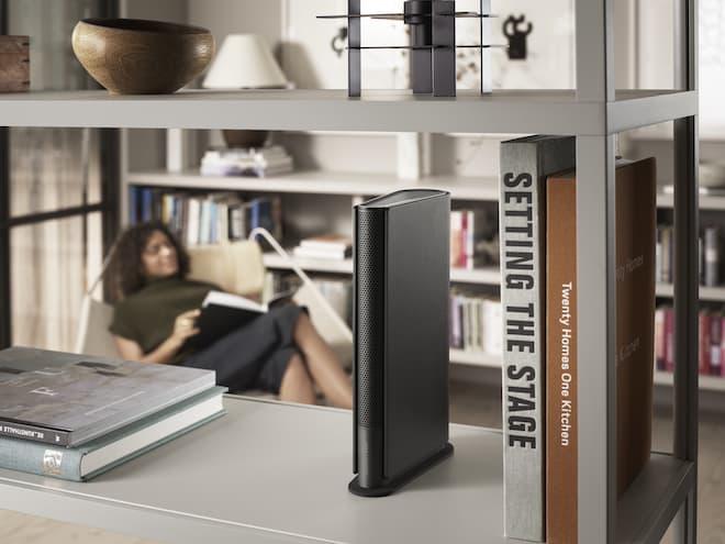 Beosound Emerge Wireless Speaker in Black Anthracite on bookshelf