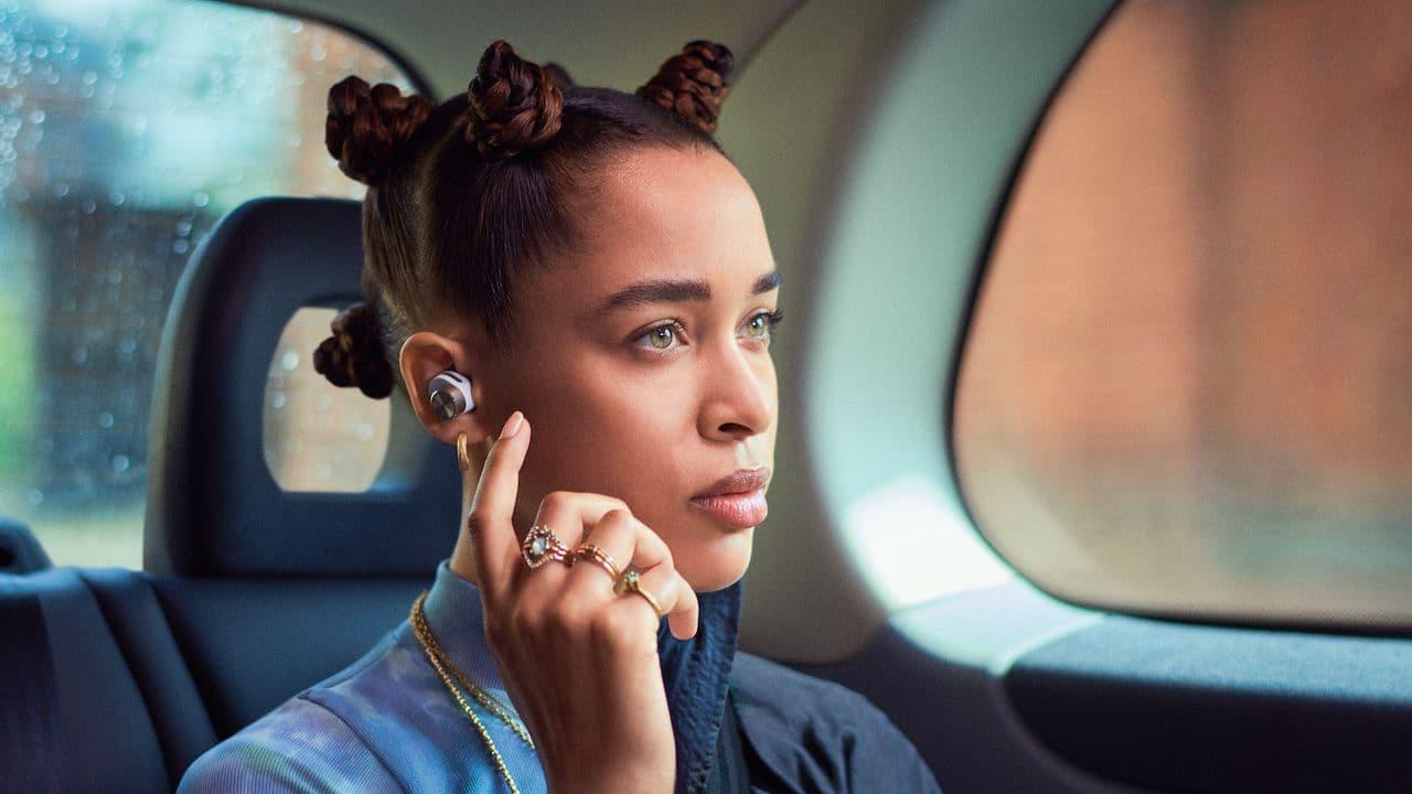 Woman wearing Bowers & Wilkins PI7 True Wireless Earphones