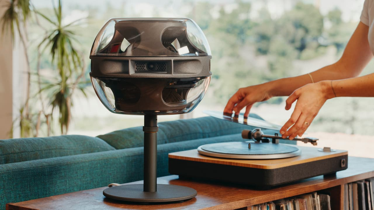 Syng Cell Alpha Speaker next to record player