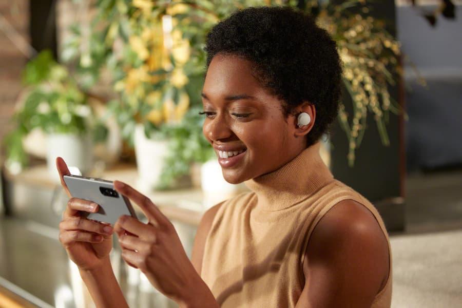 Woman wearing Sony WF-1000XM4 wireless earbuds silver