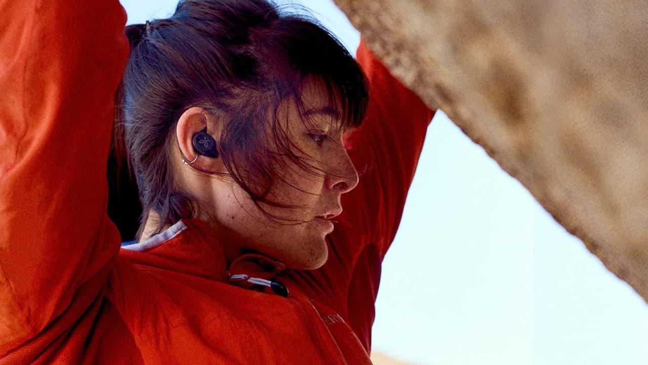 Active Woman Wearing Jaybird Vista2 Wireless Sport Earbuds