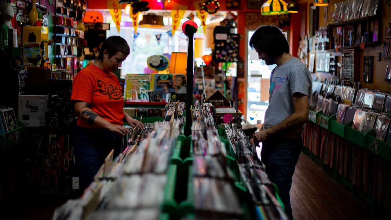 Customer browsing albums at The Electric Kitsch Record Store in Bay City, Michigan