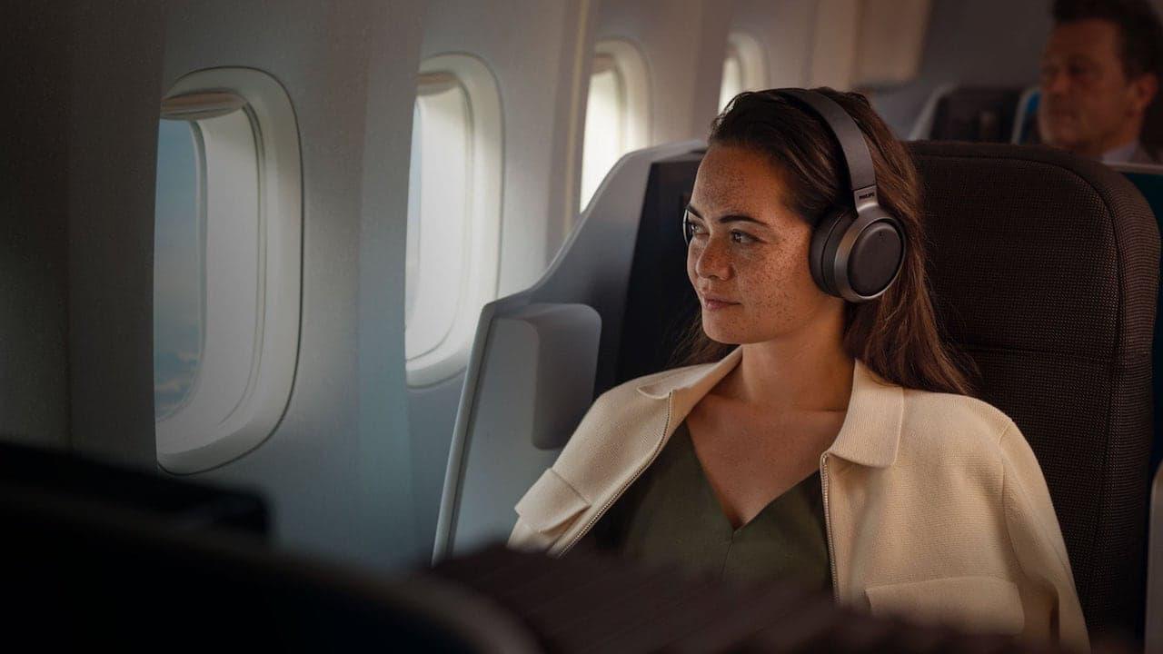 Philips Fidelio L3 Headphones Woman Lifestyle on Airplane