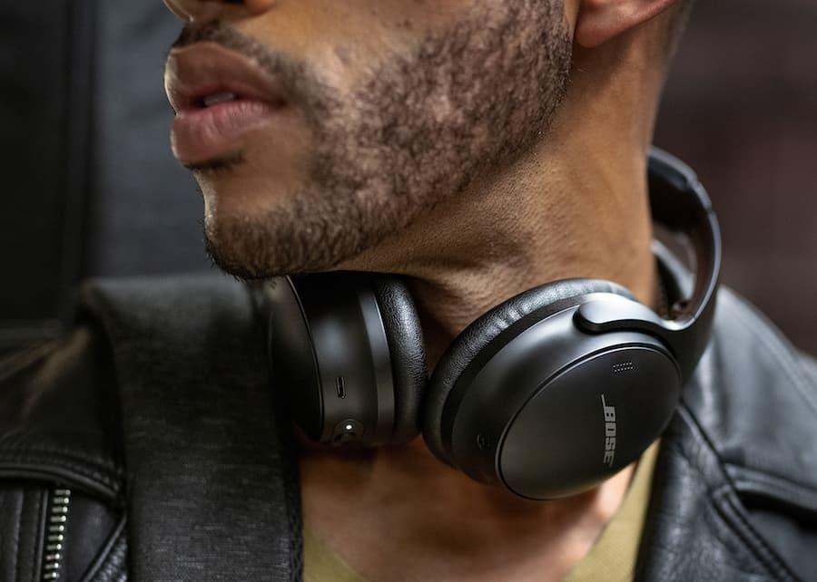 Bose QuietComfort 45 Wireless Noise-cancelling Headphones Black on Man Around Neck Lifestyle