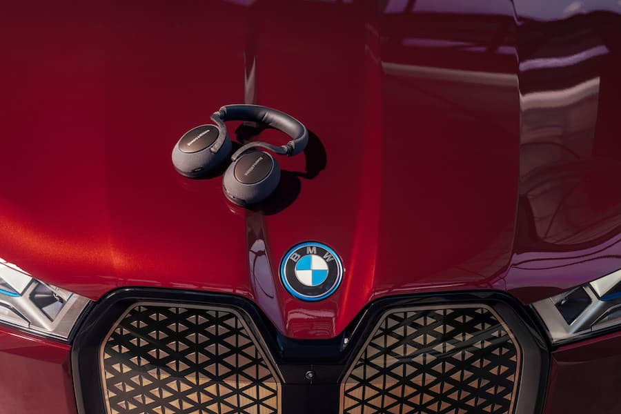 BMW iX Exterior with Bowers & Wilkins PX7 Headphones on Hood