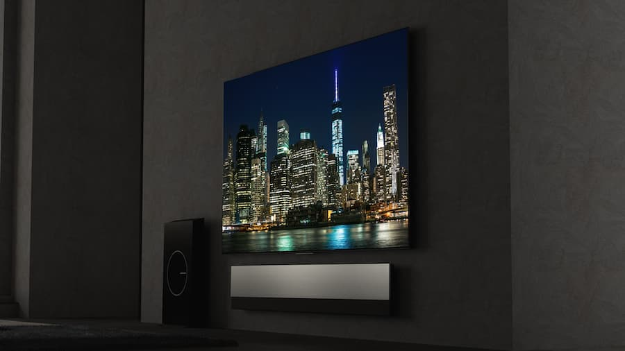 TCL X925PRO 8K TV with Onkyo Soundbar and Bass Subwoofer at Night