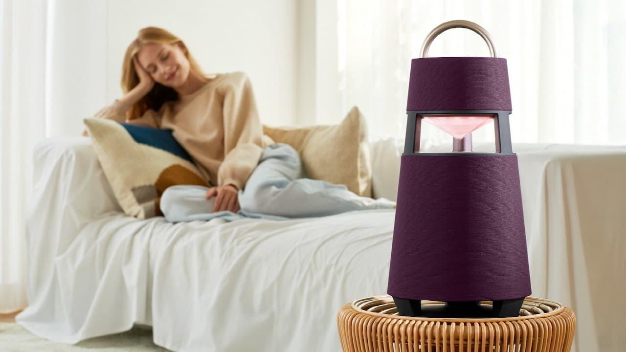 LG XBOOM 360 Wireless Speaker with Magenta Mood Light Lifestyle