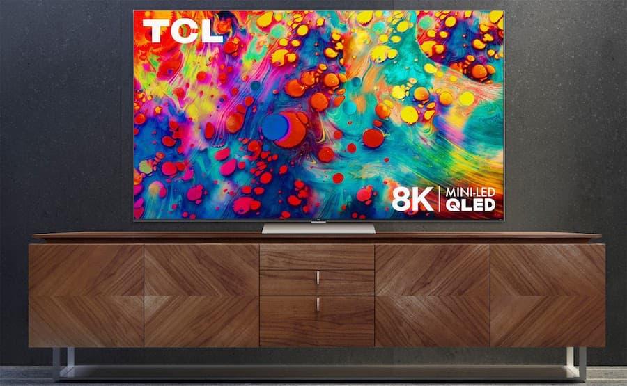 TCL 6 Series 8K TV 2021 on wood media cabinet