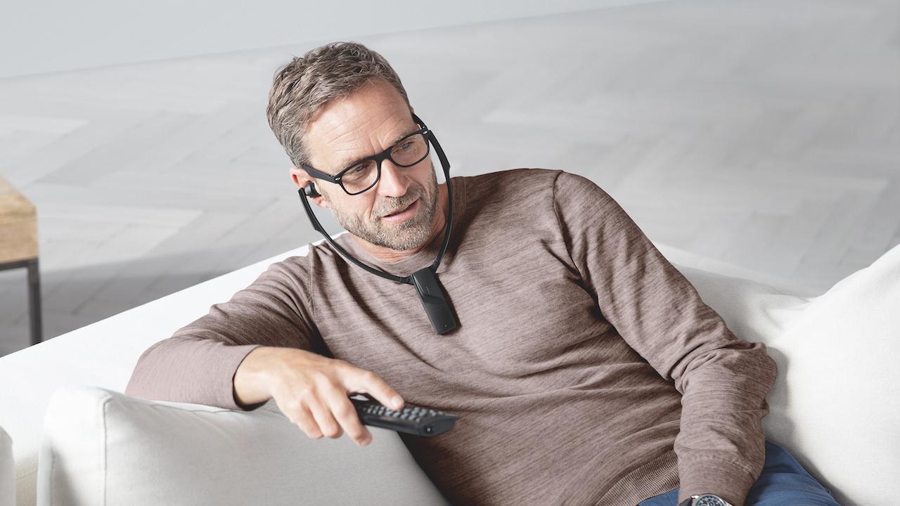Man wearing Sennheiser RS-5200 Wireless Headphones watching TV