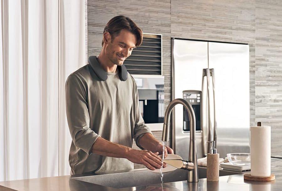 Sony SRS-NS7 Wireless Neckband Speaker Lifestyle on man in kitchen