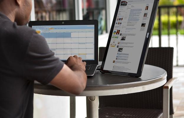 AOC E1659FWU Monitor with laptop